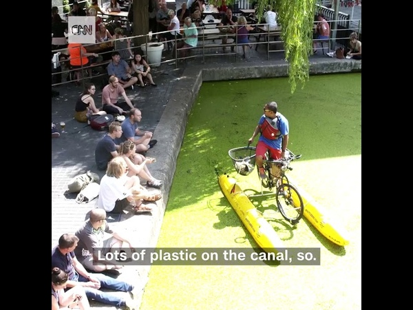 This man built a floating bicycle so he could clean trash from a river in order to raise awareness.