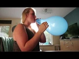 Balloon challenge with a tight blue balloon blow to pop girl