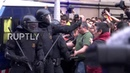 Spain Catalan protesters clash with police in mass demo after Puigdemont arrest