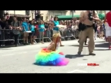 CowgerNation - NYC GAY PRIDE PARADE 8 year old boy struts and twirls for homosexuality.