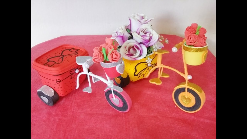 Triciclo com pote de margarina e arames