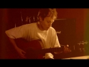 AC⁄DC - Angus Young playing acoustic guitar
