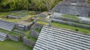 Drone/Aerial footage of Mayan pyramid ruins in northern Belize Altun Ha ruins