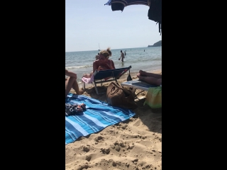 Nude couple playing on the beach