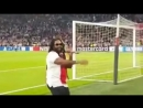 Bob Marley's son Damien singing his father's famous Three Little Birds with Ajax supporter