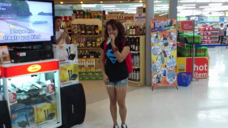 A Random Girl Steps Up To A Karaoke Machine and Floors Everyone