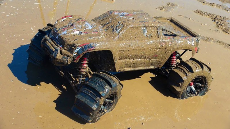 RC ADVENTURES - MUD BAPTiSM - XMAXX w PADDLE TiRES
