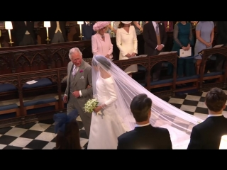 Meghan Markle walks down aisle to Prince Harry ( The Royal Family Channel )