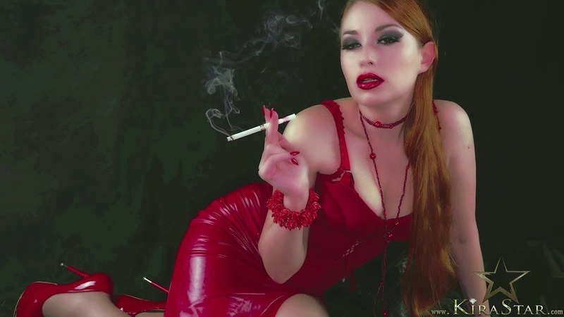 GORGEOUS DOMINATRIX SMOKES CIGARETTE IN RED