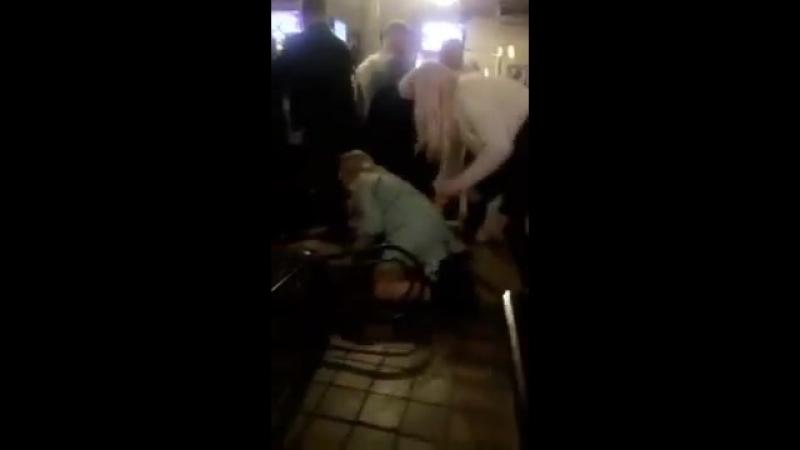 Girl falls backwards on a chair