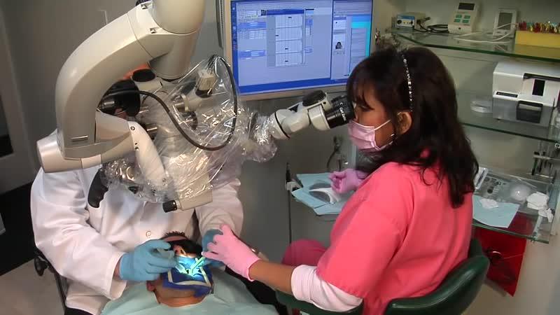 Эргономика в работе стоматолога и ассистента при использовании дентального операционного микроскопа 67.