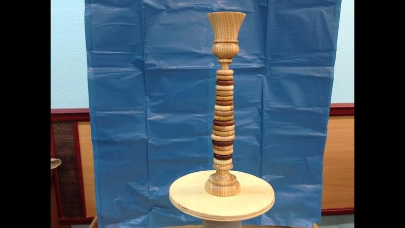 Игрушка пирамидка собранная из деревянных колец разного диаметра