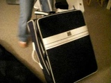 Kalee in a suitcase
