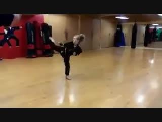 little girl with a black belt in karate