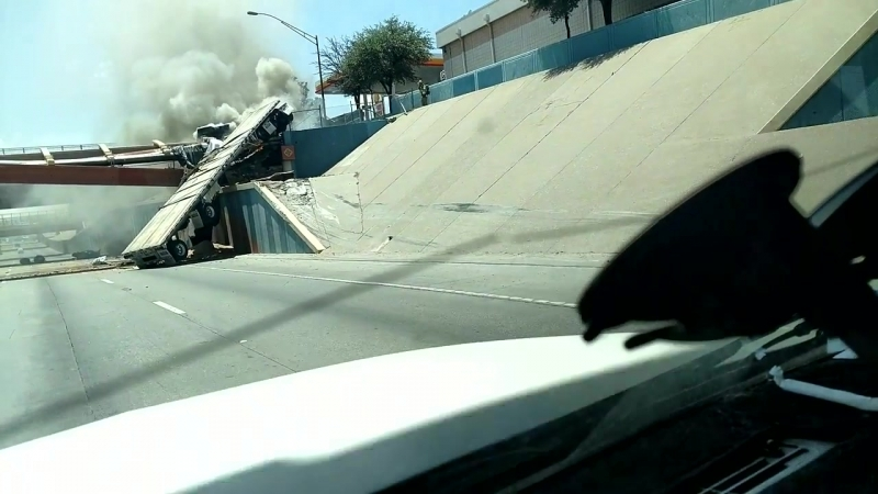 Semi Truck Goes Airborne Over Utility Bridge __ ViralHog