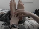 Girlfriend wrapped in blanket and feet tickle