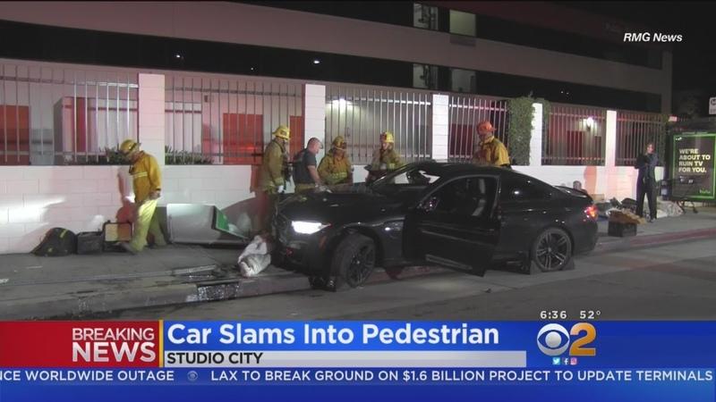Driver Arrested After BMW Hops Curb Lands On Sleeping Homeless Man