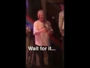 Old woman using beer bottles as musical instruments smashes them