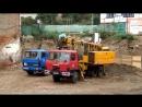 Tatra 815 UDS 114 nakládá Liaz na stavbě Татра УДС