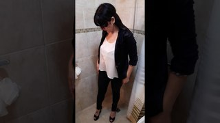 Washing the high heels and taking a fully clothed shower!