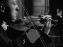 Jascha Heifetz plays Tchaikovsky Violin Concerto_ 1st mov