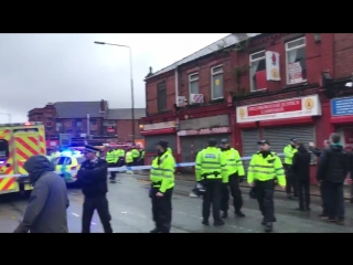 Police and ambulance in attendance at the Albert pub next to Anfield.