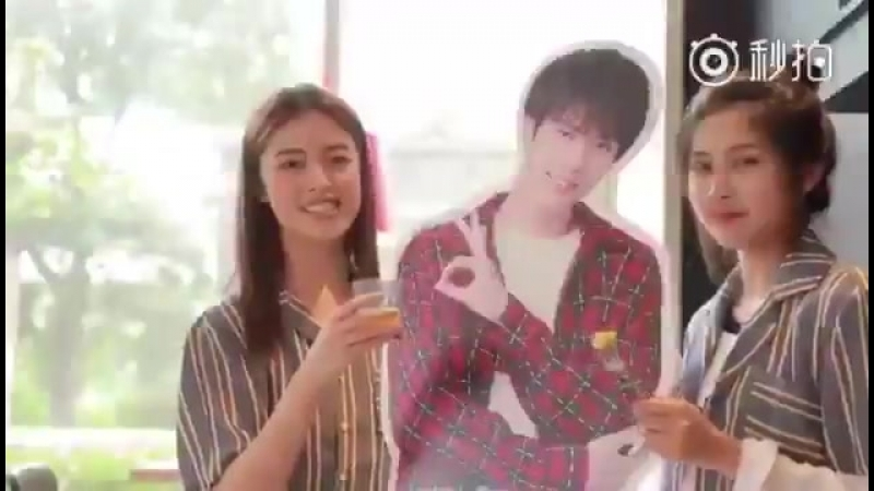 A group of evanisms dancing to the pizza hut song with Yanjun's firewalking top and his standee