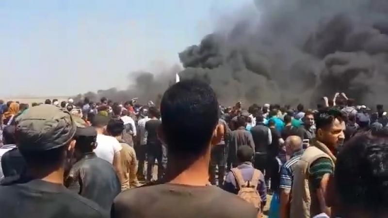 Столкновения палестинских демонстрантов с израильскими силовиками на границе сектора Газа