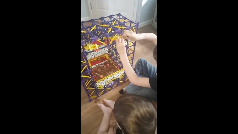 Kids play with homemade 2p machine