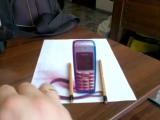 Илюзия с мобильным телефоном
