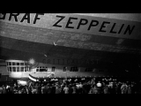 Men repair damaged fin of LZ-127 Graf Zeppelin airship in hangar after arriving i...HD Stock Footage