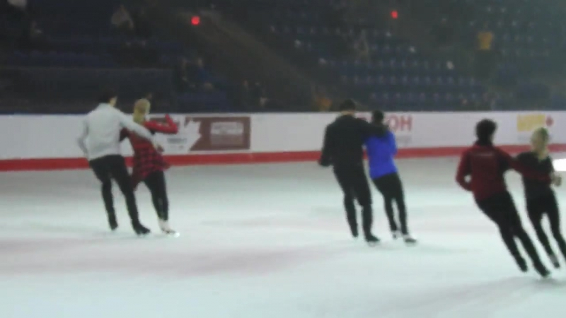 Scott tugs and twirls Tessa's ponytail