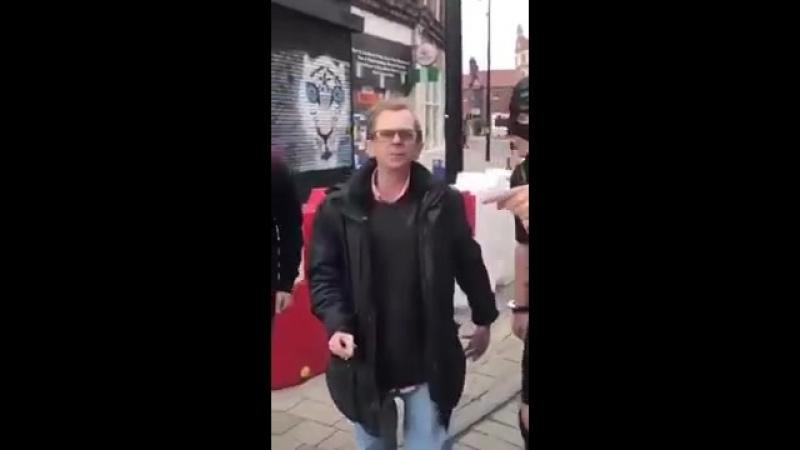 Lad dressed in a gimp suit poses handcuffed to the Wealdstone Raider