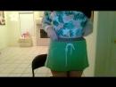 Девушка показывает торчащие из под джинсовых шорт колготки  Girl shows pantyhose under jeans shorts