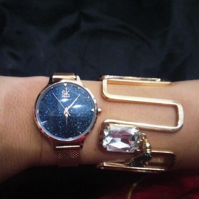 Часы Shenke с мерцающим циферблатом