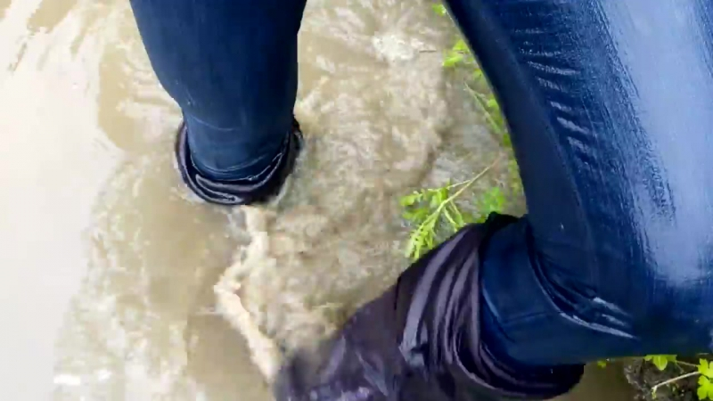 A girl in high boots with high heels in the water and mud MOV 0089 21 2