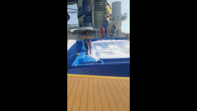 Lad keeps falling over on surf machine