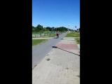 Старший брат научился катать на велосипеде братишку и сестренку.