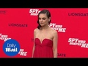 Regal in Red! Mila Kunis stuns at 'Spy Who Dumped Me' premiere - Daily Mail