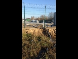 Слив воды за забор завода