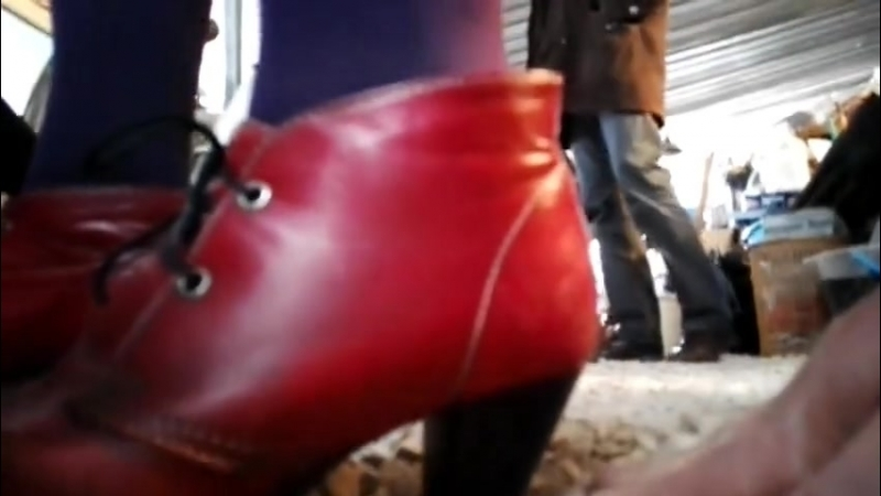 Hand trample red high heels