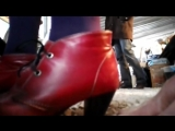 Hand trample red high heels
