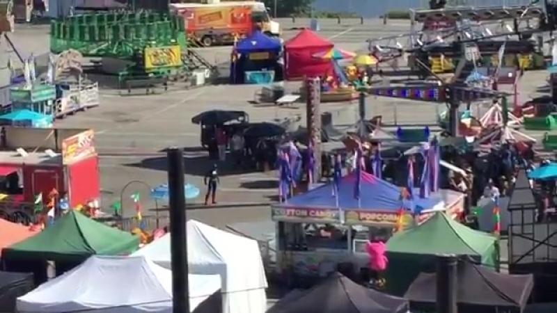 A very far away video of Supergirls new power ranger blasting a civilian at the fair @WhatsFilming