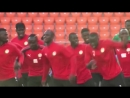 Senegal dancing and singing during training session