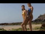 Two micro bikini models in daring slingshot swimsuits - beach photoshoot