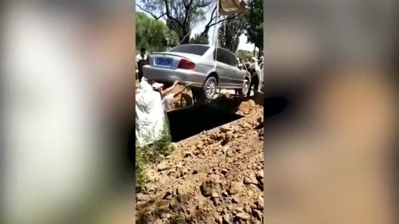 Chinese villagers bury car lover in old Hyundai as dying wish is granted.mp4