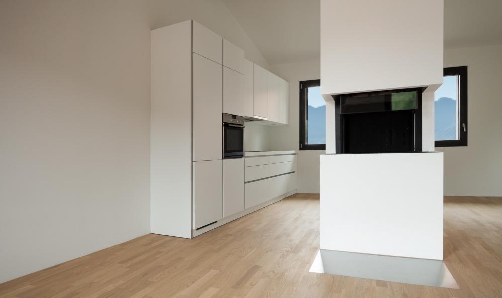 Дизайнер интерьера настраивает жилые помещения дома, чтобы соответствовать эстетическим предпочтениям его владельца.