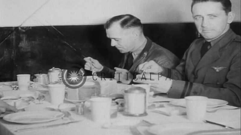 A man shaves and others eat food aboard USS Akron in flight over the west coast o...HD Stock Footage