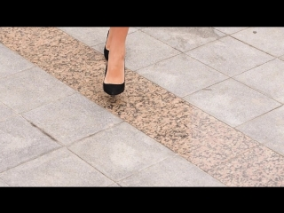 Female feet close up. Businesswoman walk in a high-heeled shoes.