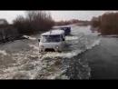 Переправа через затопленную дорогу